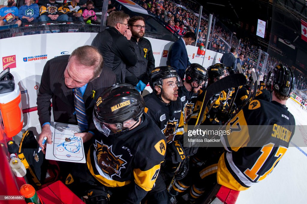 Hamilton Bulldogs' coach Ron Wilson goes over a play on the bench with Ryan Moore #40 of Hamilton Bulldogs against the Acadie-Bathurst Titan at Brandt Centre - Evraz Place on May 22, 2018 in Regina, Canada.