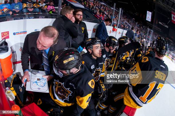 Hamilton Bulldogs' coach Ron Wilson goes over a play on the bench with Ryan Moore of Hamilton Bulldogs against the AcadieBathurst Titan at Brandt...