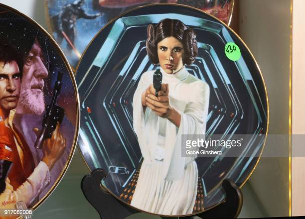 """Hamilton Collection decorative """"Star Wars"""" plate once owned by Carrie Fisher is displayed during an auction of Debbie Reynolds and Carrie Fisher..."""