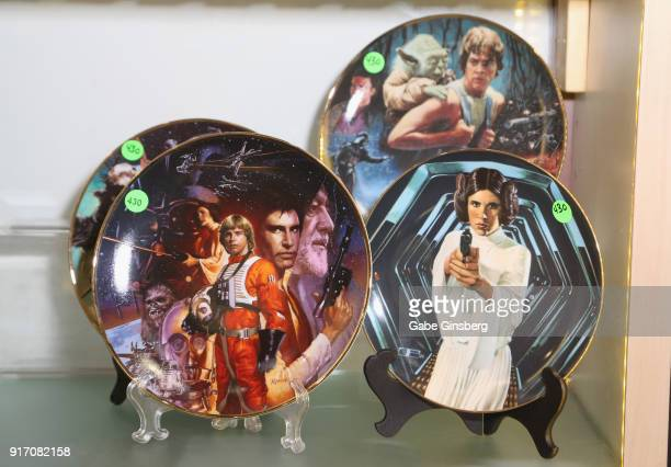 """Hamilton Collection decorative """"Star Wars"""" plates once owned by Carrie Fisher are displayed during an auction of Debbie Reynolds and Carrie Fisher..."""
