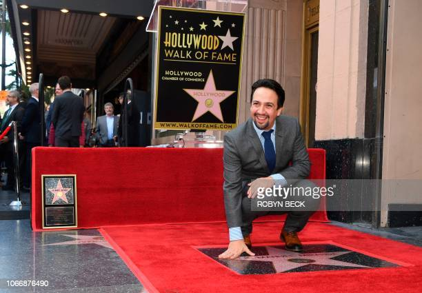 Hamilton creator Lin-Manuel Miranda poses as he celebrates getting his Star on the Hollywood Walk of Fame on November 30, 2013 in Hollywood,...