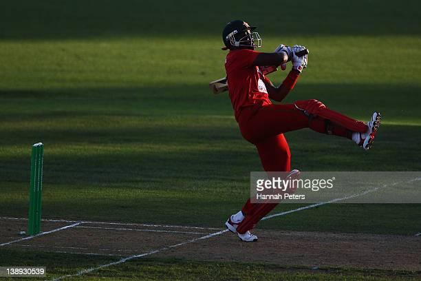 Hamilton Masakadza of Zimbabwe pulls the ball away for six runs during the second International Twenty20 match between New Zealand and Zimbabawe at...