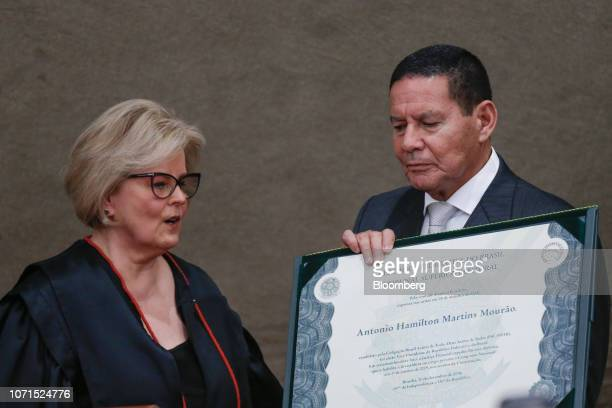 Hamilton Mourao Brazil's vice presidentelect receives a certificate from Justice Rosa Weber chief of the Electoral Supreme Court left during a...