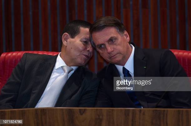 Hamilton Mourao Brazil's vice presidentelect speaks with Jair Bolsonaro Brazil's presidentelect right during a ceremony confirming their election...