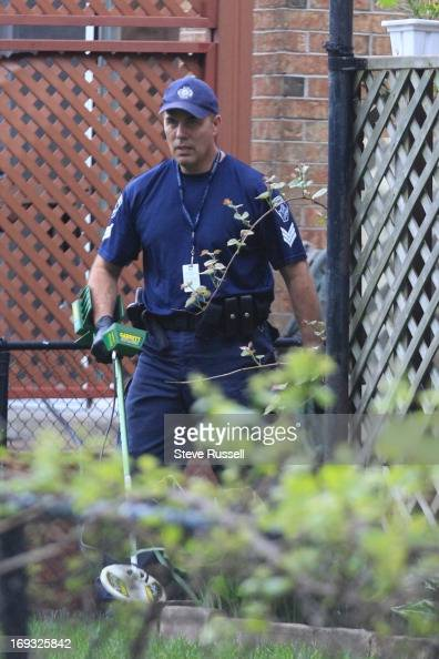 Hamilton police forensics use a metal detector to look for
