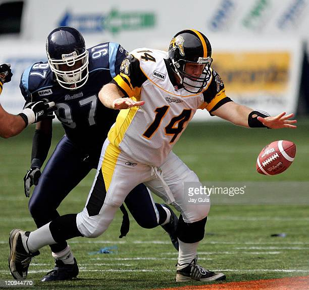 Hamilton QB Danny McManus fumbles after being hit by Toronto DE Jonathan Brown in CFL action on September 10 2005 at the Rogers Centre in Toronto...