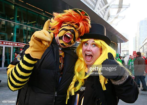 Hamilton Tiger-Cat fans cheer outside BC Place stadium before the 102nd Grey Cup Championship Game between the Calgary Stampeders and the Hamilton...