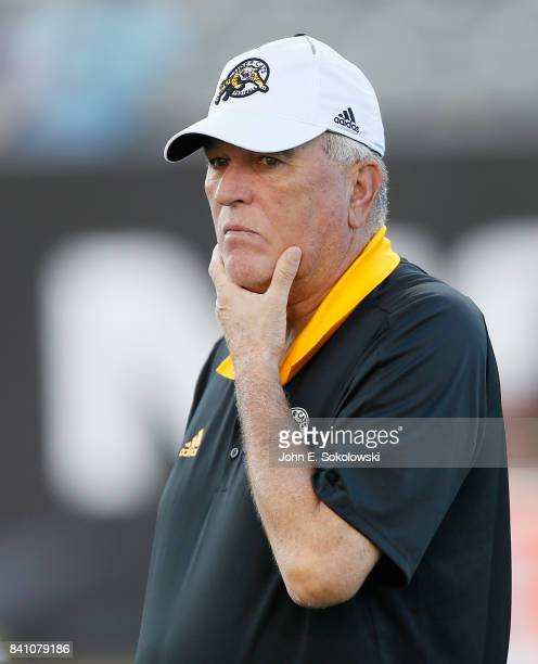 Hamilton TigerCats assistant coach June Jones during the warmup of a CFL game at Tim Hortons Field on August 18 2017 in Hamilton Ontario Canada...