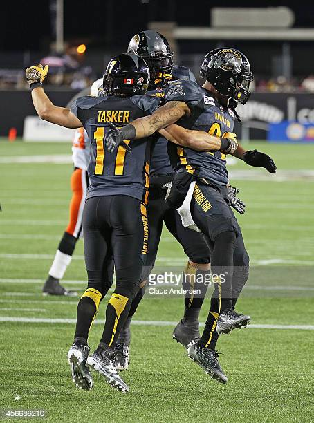 Hamilton Tigercats Mossis Madu prematurely celebrates a score against the BC Lions in a CFL football game at Tim Hortons Field on October 4 2014 in...