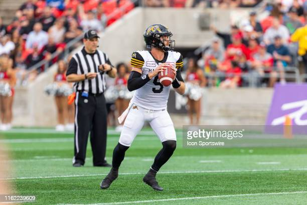 Hamilton Tiger-Cats quarterback Dane Evans looks to throw a pass during Canadian Football League action between the Hamilton Tiger-Cats and Ottawa...