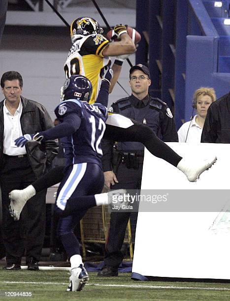 Hamilton WR Kamau Peterson makes a TD catch behind the coverage of Toronto DB Adrion Smith in CFL action Toronto Argonauts won the game with a score...