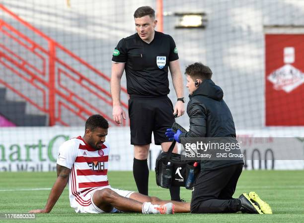 Hamiltons Marios Ogkmpoe goes down with an injury during the Ladbrokes Premiership match between Hamilton and Hibernian at the FOY Stadium on October...
