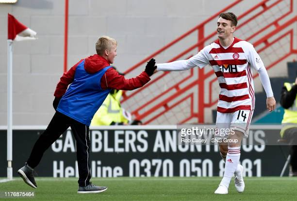 Hamiltons Ross Cunningham celebrates his goal with a ball boy during the Ladbrokes Premiership match between Hamilton and Hibernian at the FOY...
