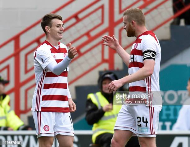 Hamiltons Ross Cunningham celebrates his goal with team mate Brian Easton during the Ladbrokes Premiership match between Hamilton and Hibernian at...