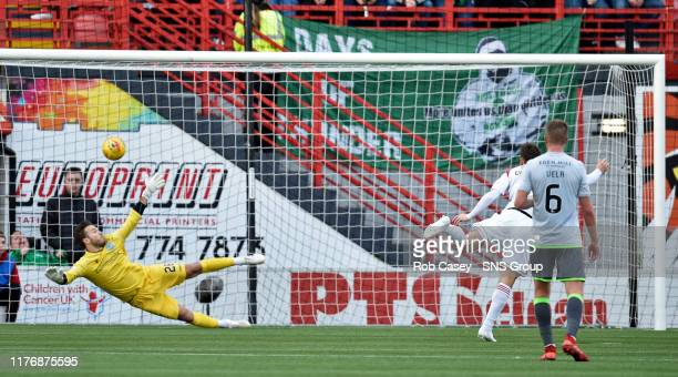 Hamiltons Ross Cunninghame scores a penalty to make it 11 during the Ladbrokes Premiership match between Hamilton and Hibernian at the FOY Stadium on...