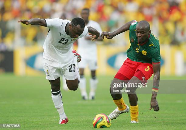Haminu Draman of Ghana and Thimothee Atouba of Cameroon during the 2008 African Cup of Nations Semi Final match between Ghana and Cameroon at the...