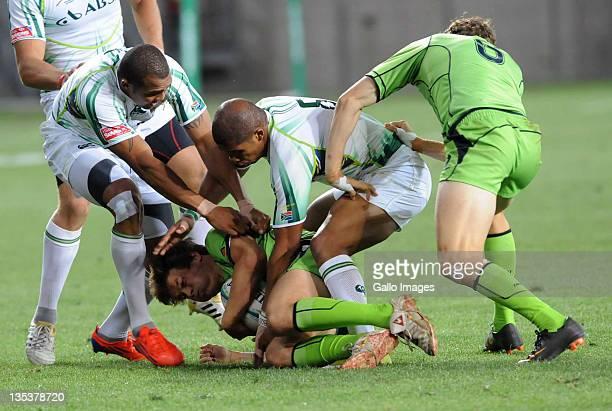 Hamish Angus of Australia tackled by Bernado Botha and Cornal Hendricks of South Africa during the match between South Africa and Australia on day...