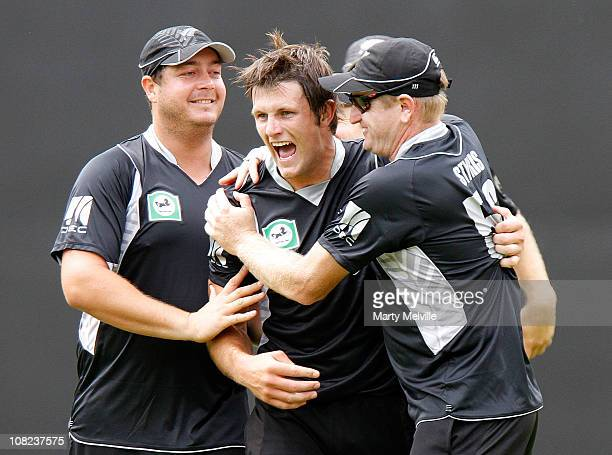 Hamish Bennett Jesse Ryder and Scott Styris of the Blackcaps celebrate Kamran Akmal of of Pakistan being caught out during game one of the One Day...