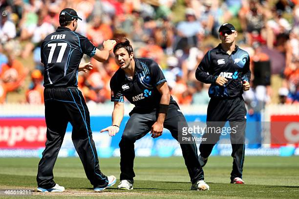 Hamish Bennett of New Zealand celebrates his wicket of Ambati Rayudu of India with Jesse Ryder during game four of the men's one day international...