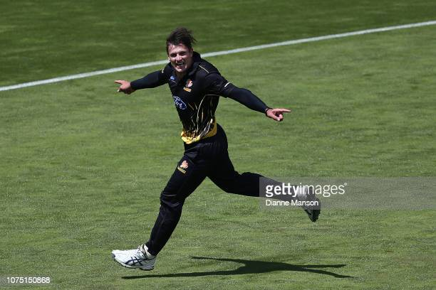 Hamish Bennett of the Wellington Firebirds celebrates the dismissal of Anaru Kitchen of the Otago Volts during the Ford Trophy Final match between...
