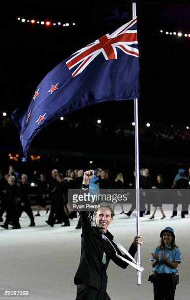 Hamish Carter flag bearer for New Zealand leads his team mates during the Opening Ceremony for the Melbourne 2006 Commonwealth Games at the Melbourne...
