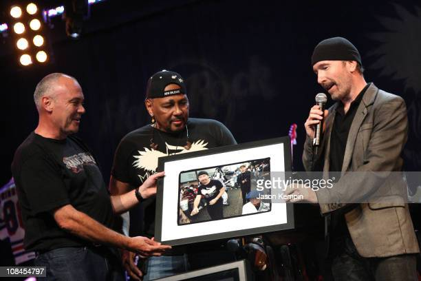 Hamish Dodds CEO of Hard Rock International musician Aaron Neville and musician The Edge of U2 attend the Icons Of Music II Auction Benefitting Music...