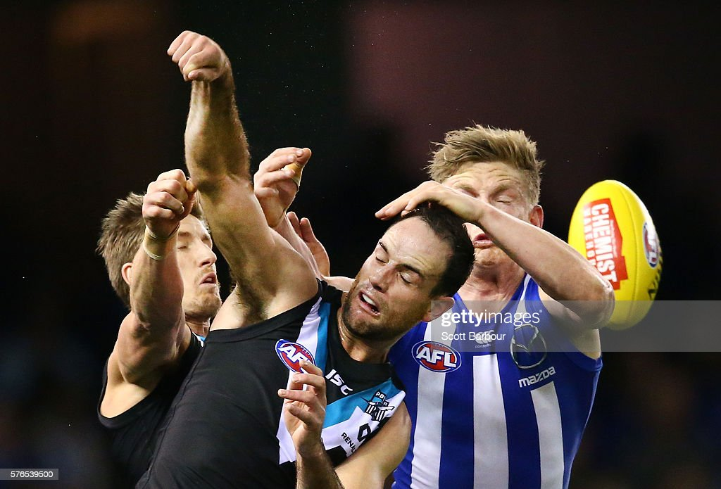 Hamish Hartlett and Matthew Broadbent of the Power compete for the ball with Jack Ziebell of the Kangaroos during the round 17 AFL match between the North Melbourne Kangaroos and the Port Adelaide Power at Etihad Stadium on July 16, 2016 in Melbourne, Australia.