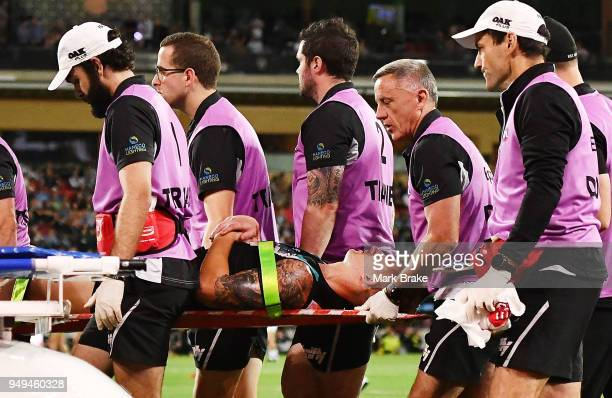 Hamish Hartlett of Port Adelaide is taken of the ground by stretcher during the round five AFL match between the Port Adelaide Power and the Geelong...
