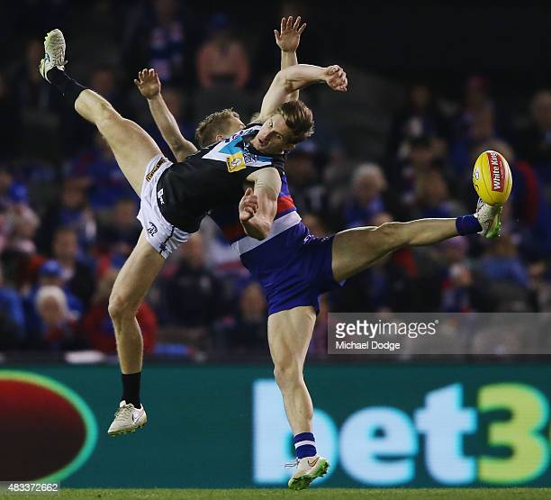 Hamish Hartlett of the Power and Lachie Hunter of the Bulldogs competes for the ball during the round 19 AFL match between the Western Bulldogs and...
