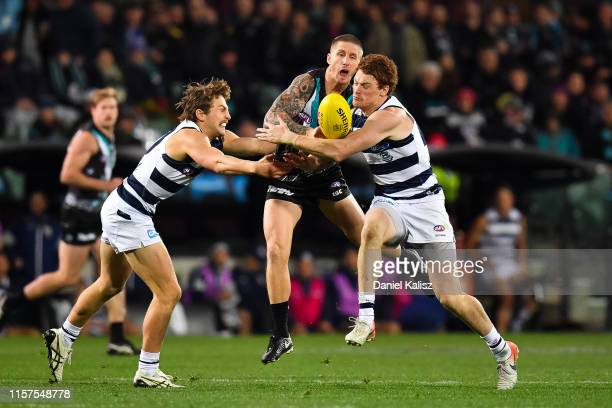 Hamish Hartlett of the Power competes for the ball during the round 14 AFL match between the Port Adelaide Power and the Geelong Cats at Adelaide...