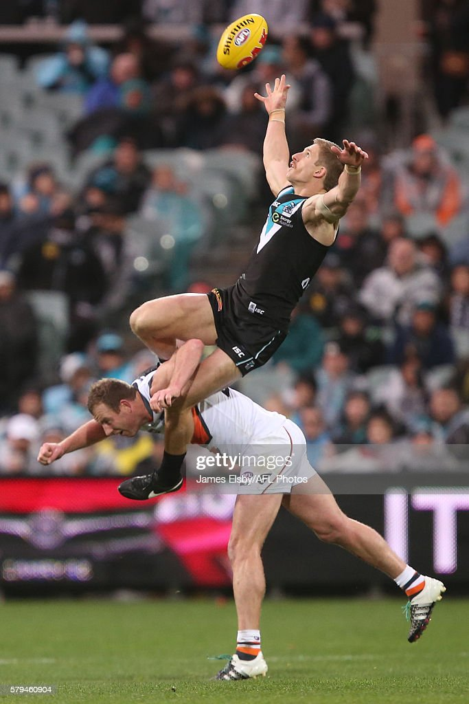 Hamish Hartlett of the Power flies over Steve Johnson of the Giants during the 2016 AFL Round 18 match between Port Adelaide Power and the GWS Giants at the Adelaide Oval on July 24, 2016 in Adelaide, Australia.