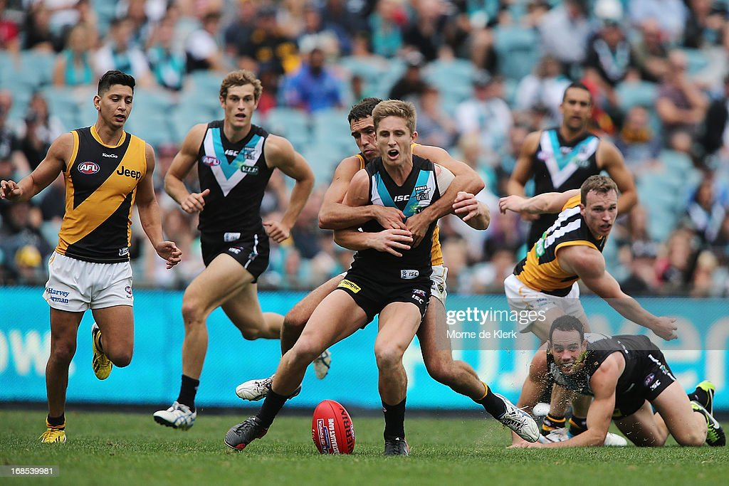 Hamish Hartlett of the Power is tackled during the round seven AFL match between Port Adelaide Power and the Richmond Tigers at AAMI Stadium on May 11, 2013 in Adelaide, Australia.