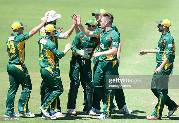 Hamish Kingston of Tasmania celebrates with team mates after taking the wicket of Liam Hatcher during the Matador BBQs One Day Cup match between...