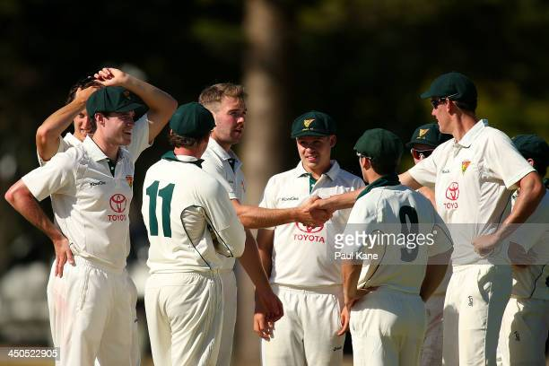 Hamish Kingston of Tasmania is congratulated by team mates after dismissing Tom Beaton of Western Australia during day two of the Futures League...