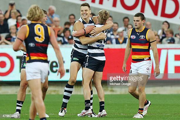 Hamish McIntosh of the Cats celebrates his goal with Josh Caddy during the round one AFL match between the Geelong Cats and the Adelaide Crows at...
