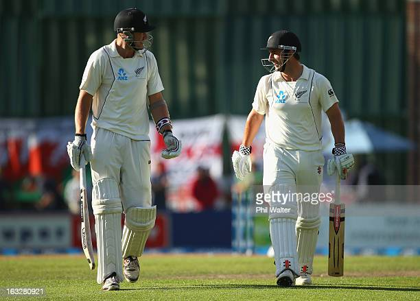 Hamish Rutherford and Peter Fulton of New Zealand leave the field at the end of day two of the First Test match between New Zealand and England at...