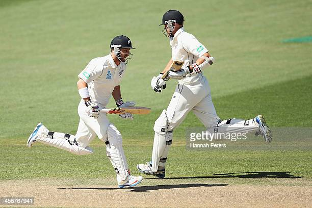 Hamish Rutherford and Peter Fulton of New Zealand take a single during day four of the Third Test match between New Zealand and the West Indies at...