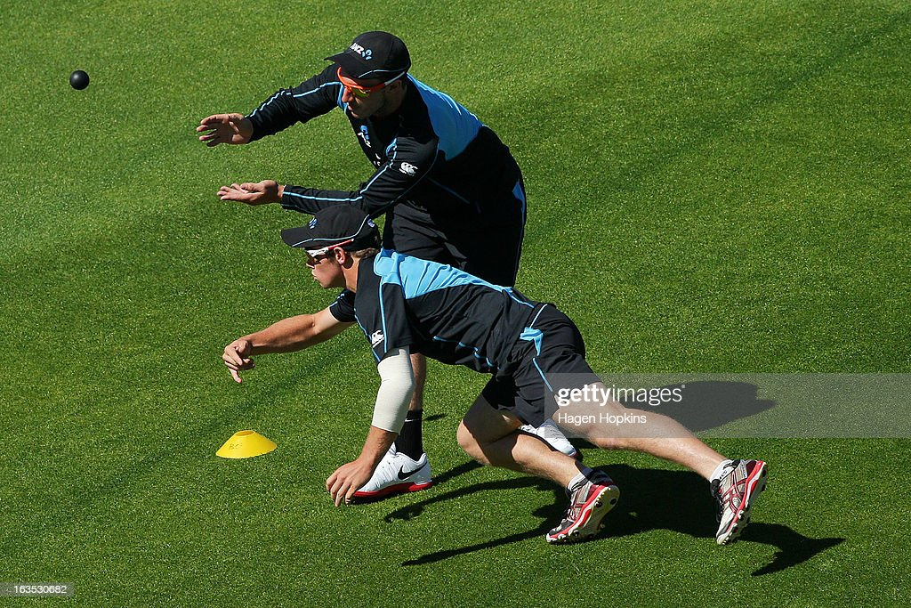 Hamish Rutherford (top) and Tom Latham play a game of handball during a New Zealand training session at Basin Reserve on March 12, 2013 in Wellington, New Zealand.