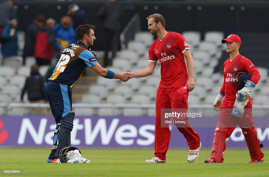 Hamish Rutherford of Derbyshire shakes hands with Tom Smith of Lancashire after the NatWest T20 Blast between Lancashire and Derbyshire at Old Trafford on May 21, 2016 in Manchester, England.