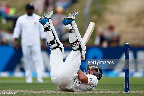 Hamish Rutherford of New Zealand falls over during day three of the Second Test match between New Zealand and Sri Lanka at the Basin Reserve on...