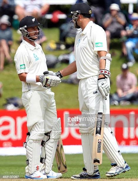 Hamish Rutherford of New Zealand is congratulated on scoring 50 runs by Peter Fulton during day one of the first test match between New Zealand and...