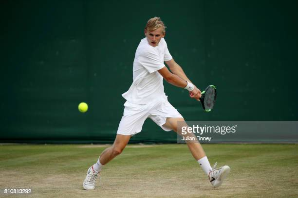 Hamish Stewart of Great Britain plays a backhand during the Boy's Singles first round match against Tomas Machac of the Czech Republic on day six of...