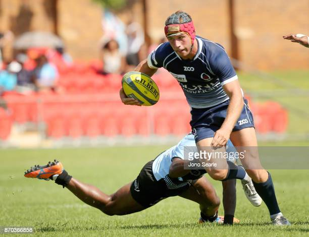 Hamish Stewart of QLD tries to make a break during the NRC Semi Final match between Queensland Country and Fijian Drua at Clive Berghofer Stadium on...