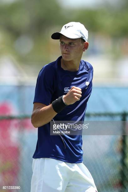 Hamish Stewart of Scotland celebrates as he competes in the Boy's Singles gold medal tennis match between James Story of Wales and Hamish Stewart of...