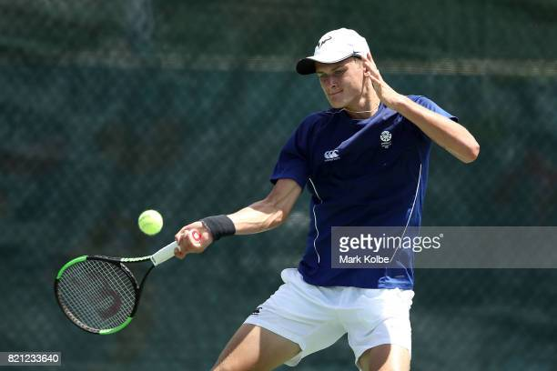 Hamish Stewart of Scotland competes in the Boy's Singles gold medal tennis match between James Story of Wales and Hamish Stewart of Scotland on day 6...