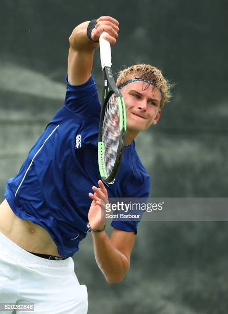 Hamish Stewart of Scotland competes in the Boy's Singles Quarterfinal tennis match between Codie VAN SCHALKWYK of Namibia and Hamish Stewart of...