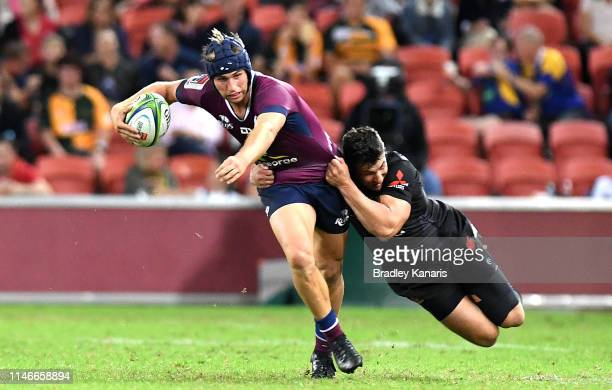 Hamish Stewart of the Reds attempts to break free from the defence during the round 12 Super Rugby match between the Reds and the Sunwolves at...