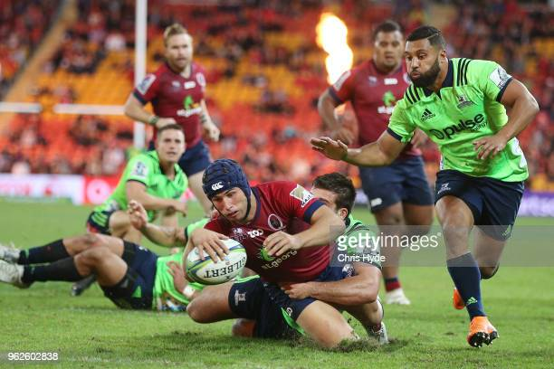 Hamish Stewart of the Reds dives to score a try during the round 15 Super Rugby match between the Reds and the Highlanders at Suncorp Stadium on May...