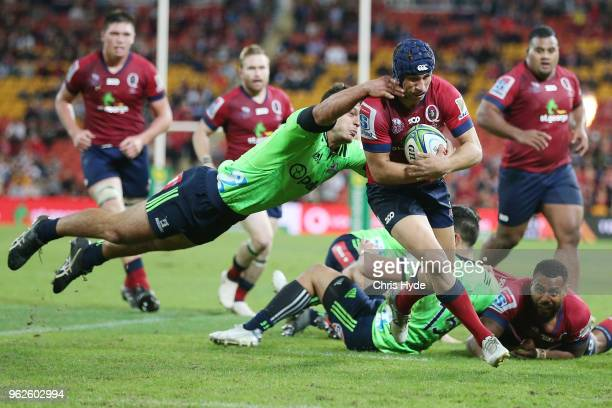 Hamish Stewart of the Reds makes a break to score a try during the round 15 Super Rugby match between the Reds and the Highlanders at Suncorp Stadium...