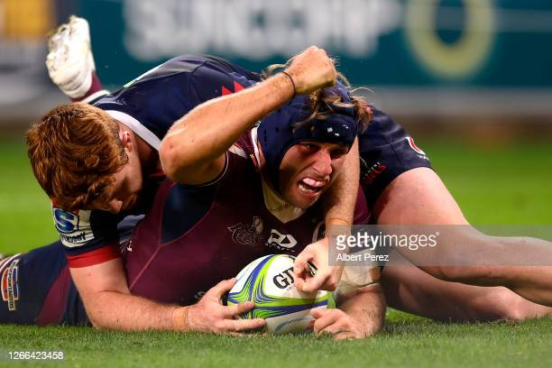 Hamish Stewart of the Reds scores a try during the round seven Super Rugby AU match between the Queensland Reds and the Melbourne Rebels at Suncorp...